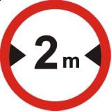 B-15 Zakaz wjazdu pojazdów o szerokości ponad ... m. Oznacza zakaz ruchu pojazdów, których szerokość (również z ładunkiem) jest większa od wartości podanej na znaku