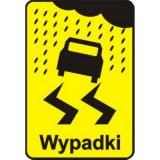 Tabliczka T-15 Wypadki. Tabliczka wskazująca miejsce częstych wypadków spowodowanych śliską nawierzchnią jezdni ze względu na opady deszczu